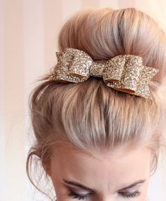 bun with gold glitter bow