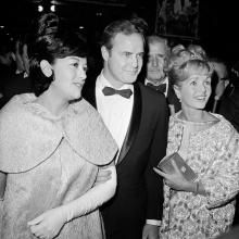 "FILE-This Nov. 15, 1962 file photo shows Marlon Brando, his wife, Mexican actress Movita Castaneda, left, and actress Debbie Reynolds, right, arriving for the West Coast premiere of ""Mutiny on the Bounty"" at the Hollywood Egyptian Theater in Los Angeles. Castaneda, the dark-haired actress who met Brando on a movie set and later married him and had two of his children died Thursday, Feb. 12, 2015 at a Los Angeles rehabilitation center after being treated for a neck injury. The Los Angeles ..."