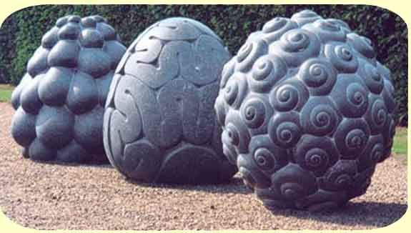 Carved in stone: Peter Randall-Page at Yorkshire Sculpture Park . These three sculptures created by Randall look said they were inspired by nature, more specifically the fruits of nature. The patterns of the fruits have be exaggerated onto the surfaces of these three sculptures, all inspired by different fruits. The detail is strong and stands out.