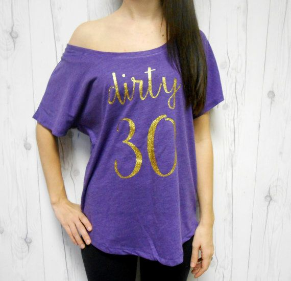 Dirty 30 Shirt / Dirty Thirty Shirt / Turning 30 Shirt / Birthday Girl Shirt / 30th Birthday Shirt / 30th Birthday Gift / 30th Birthday Tee  Welcome to Momaste Clothing Etsy Shop!  This listing is for one lightweight dolman shirt that says Dirty 30 as shown in the photo(s). J  Shirt is a mixture of 50% polyester, 25% cotton, and 25% rayon. It is a short sleeve flowy jersey shirt with dolman sleeve styling. Can be worn off the shoulder (I suggest to order a size u...