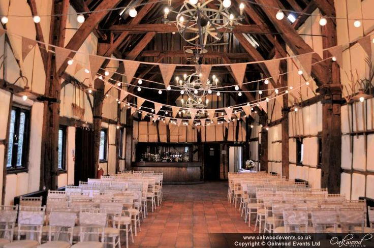 Festoon crosses of lights with hessian and lace bunting. Rustic barn wedding style!