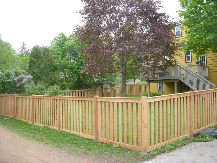 Picket fence design enclosed pickets with flat top for Wood privacy fence ideas