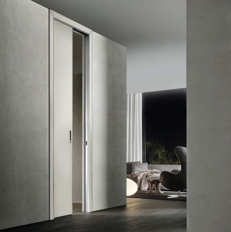 Luxor door sliding into the wall, aluminium structure, door panel, jamb and handle in lino mat lacquered glass.