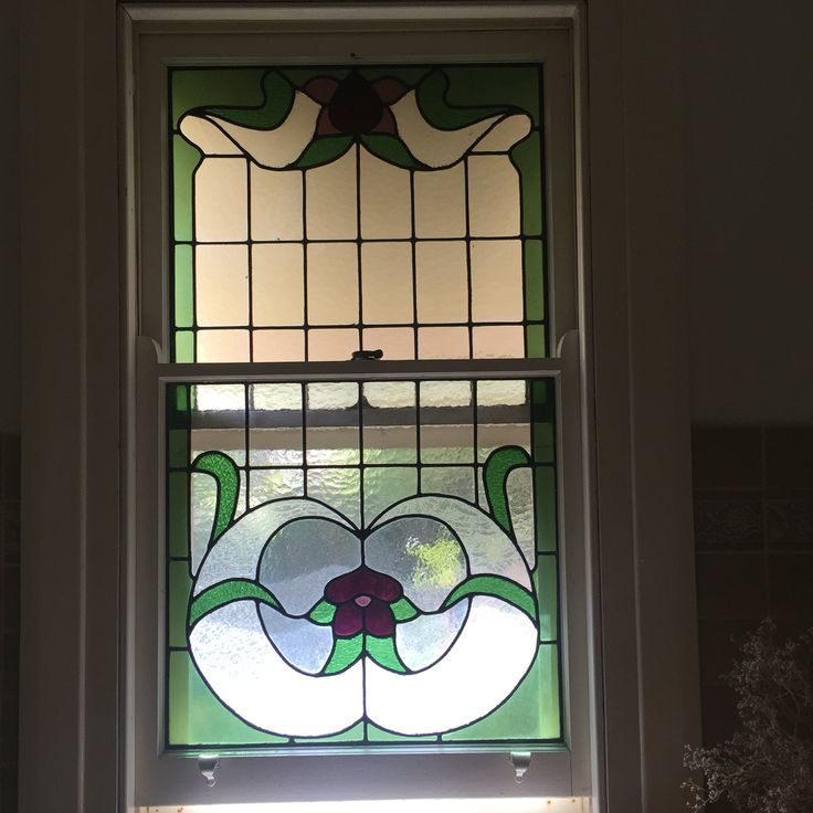 Photo 2: This enamelled window is found in a house in Horsham. It is used for many people for part of decoration. This kind of glass is very common in churches.