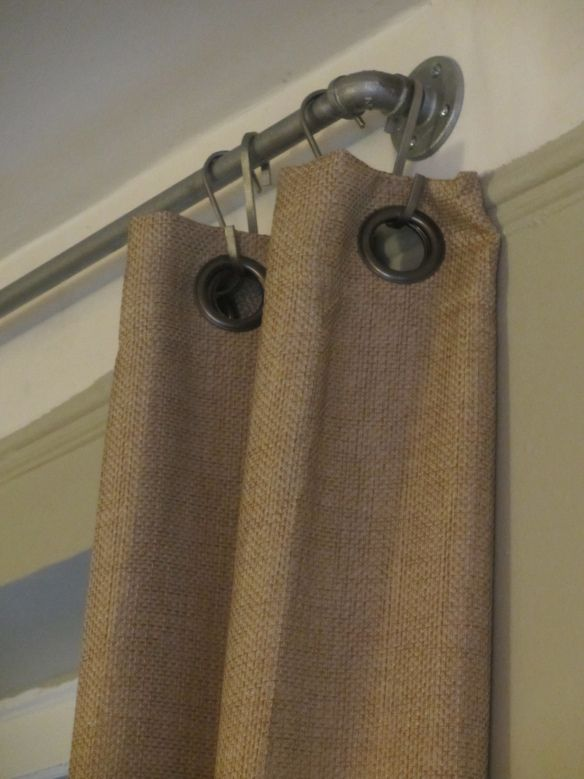 These would be slammin' in The Boy's room along with some pipe shelves.  DIY Industrial Pipe Curtain Rods by somethingwewhippedup.com