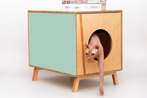 PEEKABOO side table - mid-century design for you and your pet by the modernist cat.  This is a pretty cool idea.  Could DIY.  and would be great to throw kids toys in too.