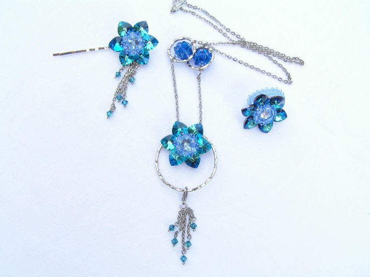 Lotus - Blue Azure Swarovski Jewelry Set  --    Elegant, sparkling Swarovski jewelry set which reminds a cloudless summer sky.  The lotus flower diameter is 33 mm.  The set includes a necklace, a ring and a hair pin.