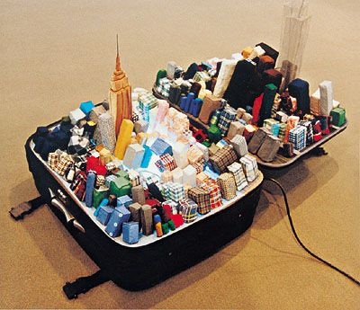 Beijing-based artist Yin Xiuzhen's Portable Cities series are models of cities inside suitcases, made using old clothes from that city's residents. In her practice, she explores issues of globalization and homogenization, but also memory and transience.