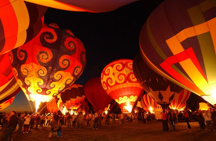 Albuquerque International Balloon Fiesta, New Mexico: early October. Over 750 hot air balloons take to the skies, some are illuminated at night, and some are uniquely shaped.