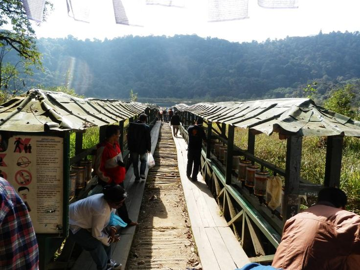 The Dock and Prayer Wheels at Holly Lake Khecheopalri near Pelling in Sikkim, India.  http://www.TaoJourneys.com