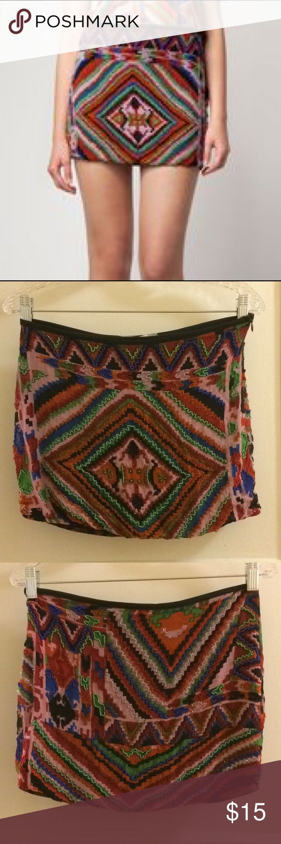 Bershka dressy collection beaded mini skirt This skirt is really cute, but really short!! Elastic bottom holds skirt in place. Fun colors and geometric pattern. Beads missing from a couple small spots as seen in photos, but still only lightly worn. Says M but fits very small Bershka Skirts Mini