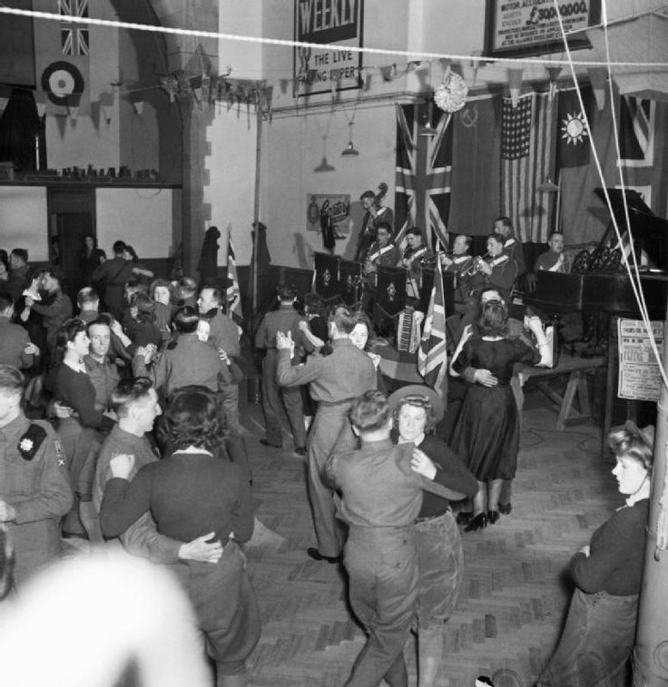 Land Girls and British soldiers at a dance in a large hall, near the Women's Land Army forestry training camp at Culford, Suffolk, May 1943.