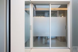 Glass office sliding doors.