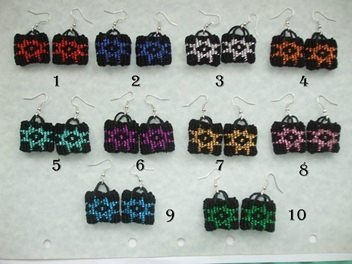 Theses are earrings.They are made from traditional Maori weaving technic.