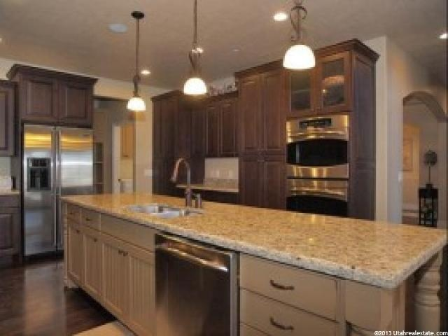 INSPIRATION PHOTOS.  Our kitchen is white granite with dark cabinets and dark wood floors
