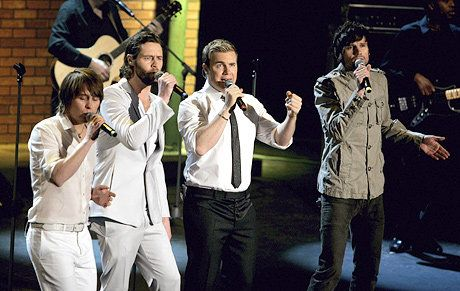 "(L-R) Pop band 'Take That' members Mark Owen, Howard Donald, Gary Barlow and Jason Orange perform during the live broadcast of ""Wetten, dass..?"" on ZDF television at the Messehalle January 20, 2007 in Friedrichshafen, Germany."