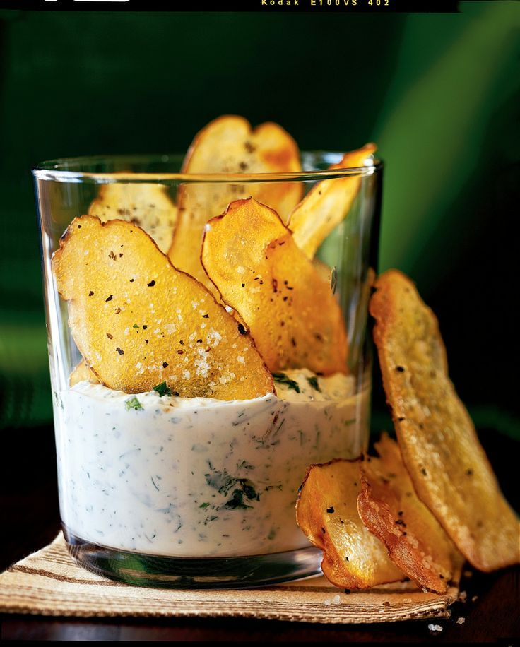 Homemade potato chips baked with a hint of olive oil parmesan cheese, herb, and garlic dip.