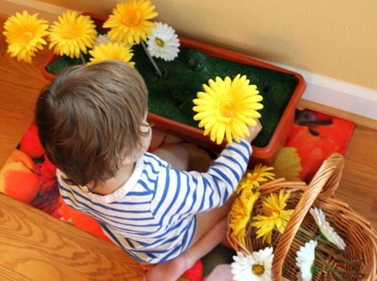 You can create a flower holder that gives your toddlers a chance to make a beautiful arrangement. This fun activity practices fine motor skills and eye hand coordination - and makes beautiful arrangements!