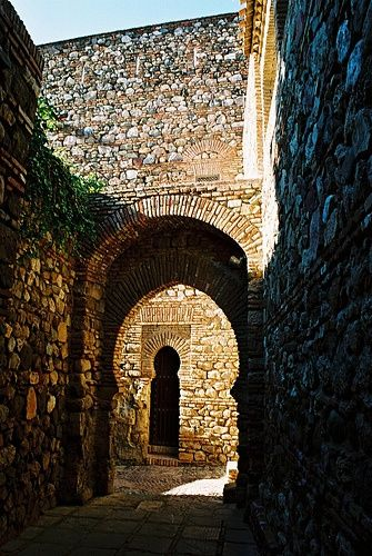 """ART OF AL- ANDALUS. Alcazaba-Malaga, Spain - The Alcazaba is a palatial fortification in Málaga, Spain. It was built by the Hammudid dynasty in the early 11th century. This is the best-preserved alcazaba """"meaning """"citadel"""" in Spain. Adjacent to the entrance of the Alcazaba are remnants of a Roman theatre dating to the 1st century BC.Ferdinand and Isabella captured Málaga from the Moors after the Siege of Málaga (1487), one of the longest sieges in the Reconquista"""