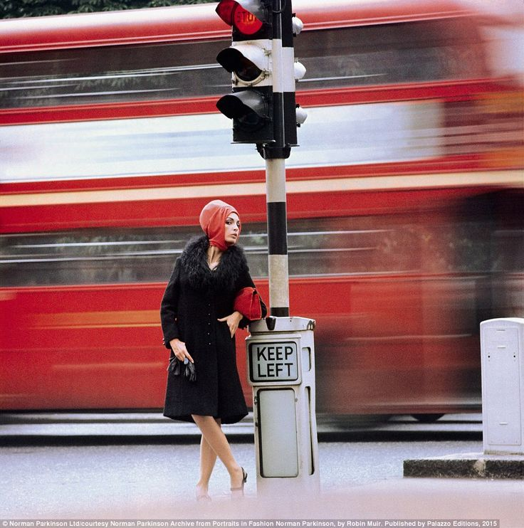 Capital chic: A model photographed in front of a passing London bus for British Vogue in 1...