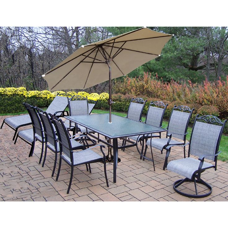 oakland living corporation sling 14 pc dining set 6 stackable chairs 2 swivel rockers 2 chaise lounges 1 end table umbrella and stand