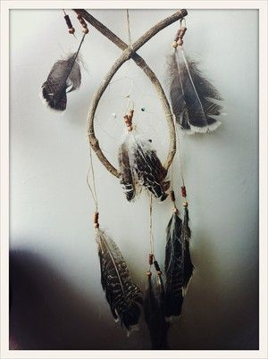 Grey Feather Hand made South American dream catcher. Keeps the bad dreams at the door.