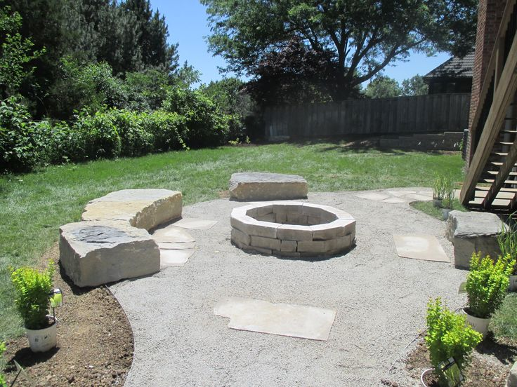 Large Limestone Seating Around Limestone Fire Pit With