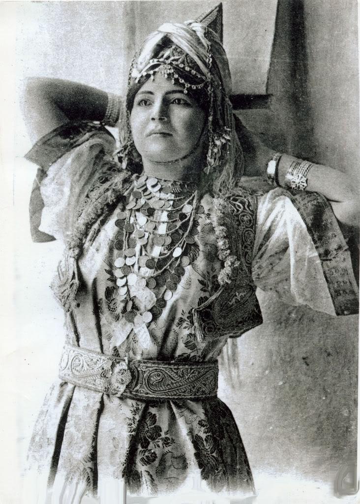 Algerian bedouin women. Embroidery metallics and heavy ...