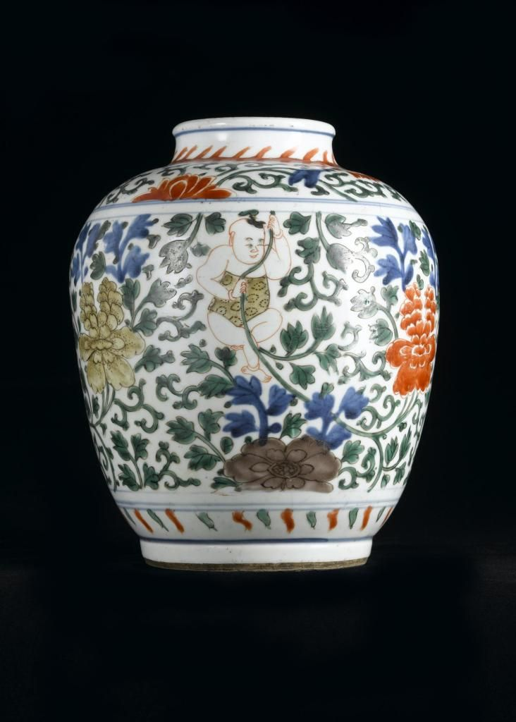 Porcelain jar painted in underglaze blue and in red, green and yellow enamels, decorated on body with three naked boys among peony scrolls, and on shoulder with a border of lotus flowers and foliage: China, Ming dynasty, early 17th century
