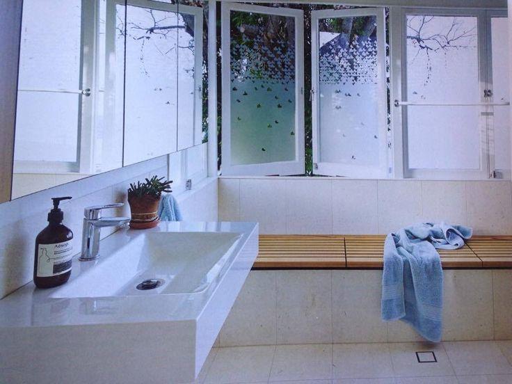 White tiles / timber trim
