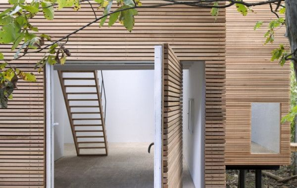 12 Pivot Door Leading To Patios: T Space by Steven Holl Architects is a newly constructed gallery onto an existing home from the '50s located on four acres in Dutchess County, New York. The entrance door, covered in two-by-two cedar planks like the rest of the structure, pivots to reveal a plywood clad floor and sparse staircase.