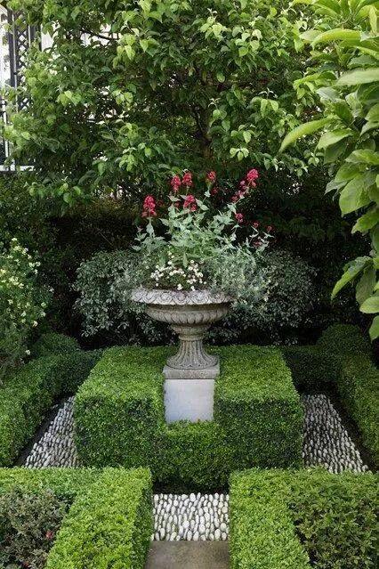 Garden with boxwoods & urn. My fav.