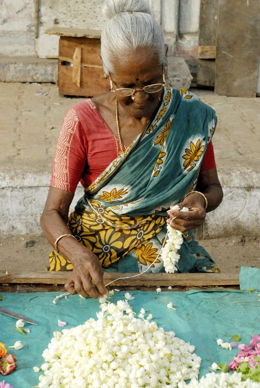 Stringing Flowers   -- India