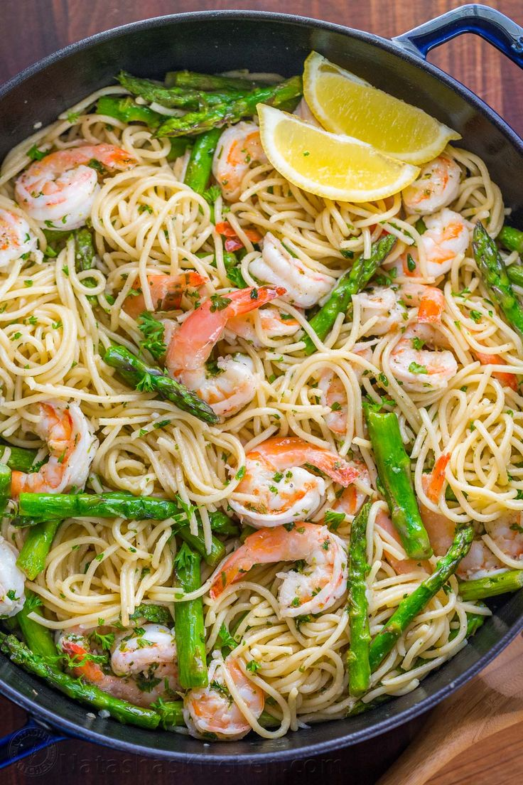 Shrimp Scampi Pasta with Asparagus has a lemon garlic and herb sauce that packs so much fresh and amazing flavor. A 30 minute shrimp scampi pasta recipe! | natashaskitchen.com
