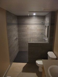 I really like this shower design - half wall, open doorway.  CC