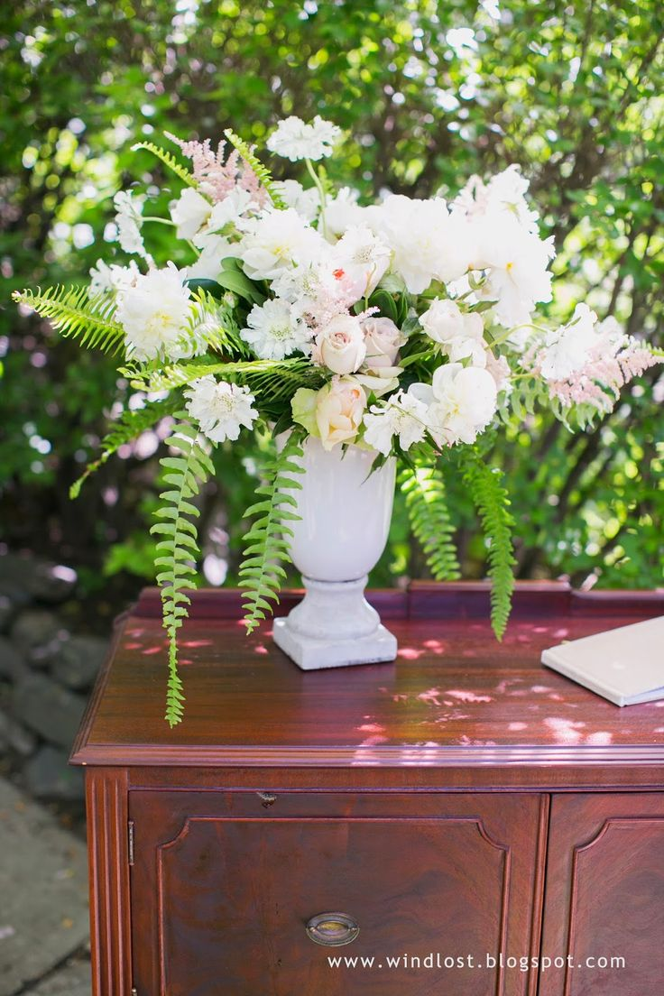 ~ Wind Lost ~ Footed urn floral arrangement at our garden ceremony location, Calgary's Reader Rock Garden. Our lovely, romantic and elegant June wedding.  Our color scheme was white/ivory, black, soft pink and gold/champagne.