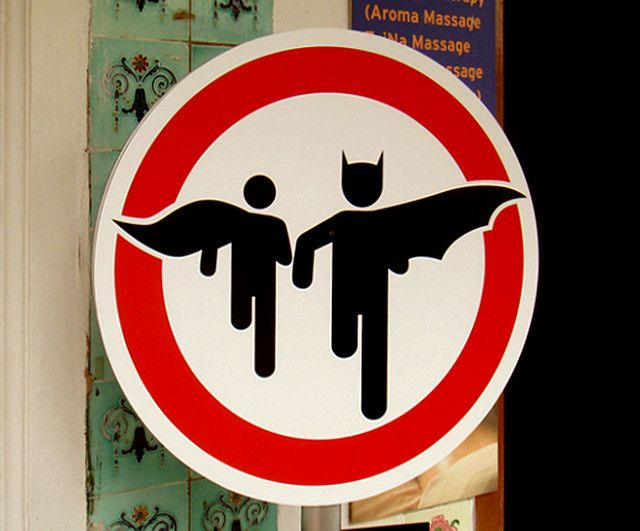 Superheroes crossing- Sign for parking lot entrance/ exit