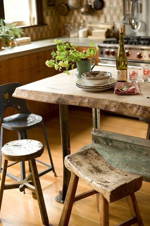 beautiful wood slab table and wall tiles in rustic kitchen
