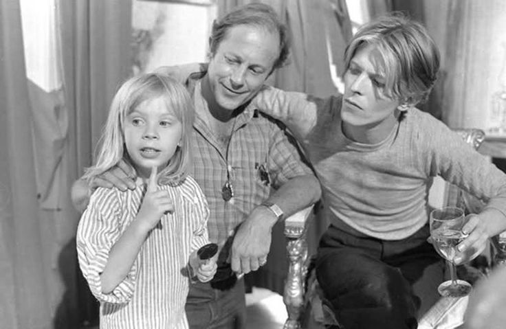 1975 - Nicolas Roeg and David Bowie as Thomas Newton with his son Duncan Jones in The Man Who Fell To Earth (backstage photo).