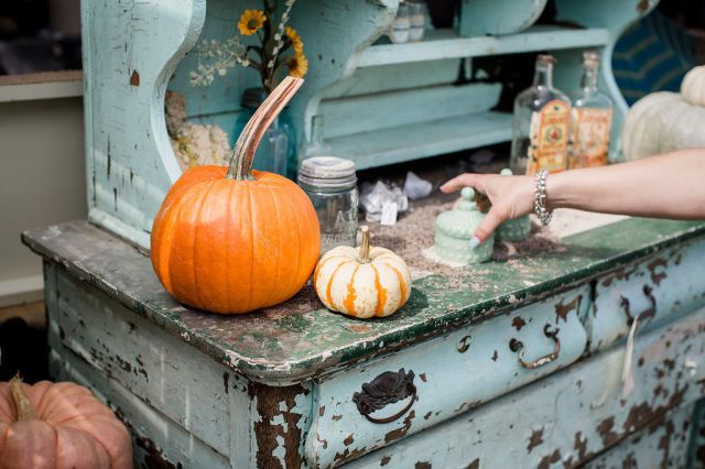 Pumpkins sit on a rustic antique vanity.  This is Small Town Junk
