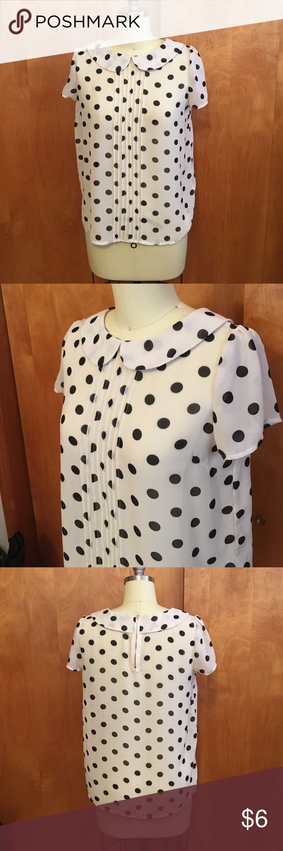 Sheer short sleeve polka dot shirt Off white short sleeve collard sheer top with black polka dots, zipper in back, gently used. Bundle discount buy 3 items or more get 30% off! Forever 21 Tops Blouses