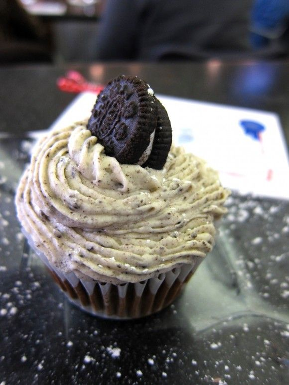 Death by Oreo Cupcake~A whole oreo on the bottom of the cupcake, oreos chopped up in the cake mix, crushed oreos in the cream cheese icing and then a little mini oreo perched on top.
