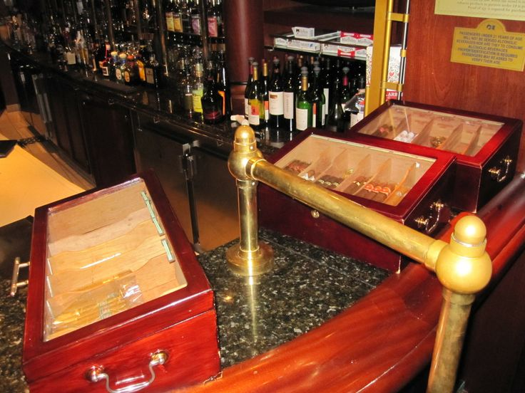 Humidors with cigars for sale in the lounge.  http://cigarczars.com/cruising-cigars.htm