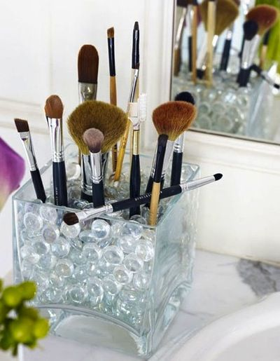 I could have created an entire post just on pretty containers for storing brushes… use small wide ones for lipsticks, glosses and mascaras, and taller ones for brushes.  Fill them with beads or coffee beans to hold brushes in place and tie in with your decor. I love these jars. image.