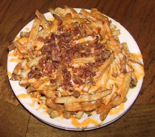 Here is a restaurant copycat recipe for Outback Steakhouse Aussie Fries. These are loaded with calories so Ive made a lighter and healthier version. Read on to find out how to make this dish at home in your own kitchen.