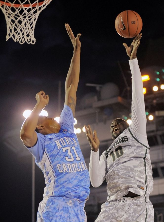 Michigan State forward Draymond Green (10) drives to the basket against North Carolina forward John Henson (31) during the first half of the Carrier Classic NCAA college basketball game aboard the USS Carl Vinson, Friday, Nov. 11, 2011, in Coronado, Calif. (AP Photo/Mark J. Terrill)