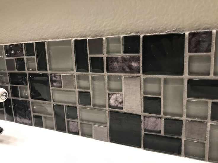 DIY Wall Tile 1-scuff area with orbital sander where tile will be placed. 2) dry fit your tile and make any necessary cuts. 3) apply adhesive with serrated trowel. 4) place tile and allow to dry 24 hrs. 5) apply grout and allow to dry 24-48 hrs 6) Apply tile and grout sealed.