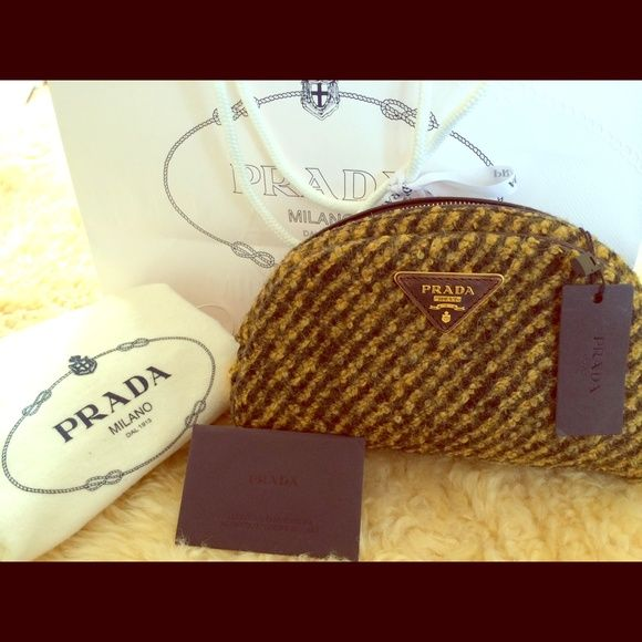 Prada clutch  Tessuto Runaway Wool Boucle Bowler New Prada Tessuto wool leather clutch, 2013 winter collection's iconic bag, absolutely new with tall the cards and original dustbag. Prada Bags