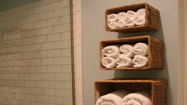 Cheap Matryoshka-style baskets making for handy bathroom towel shelves.
