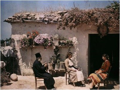 Two Girls and a Cypriot Priest Sit, Chatting During a Visit National Geographic's Greece in Color from the 1920s Photographer: Maynard Owen Williams in the 1920s